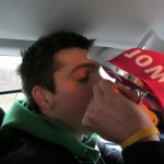 Alex enjoying a refreshing sip from the cup on the way to the airport.